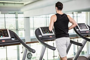 Fit man running on treadmill