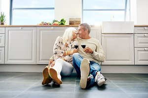 Cute senior husband and wife kissing