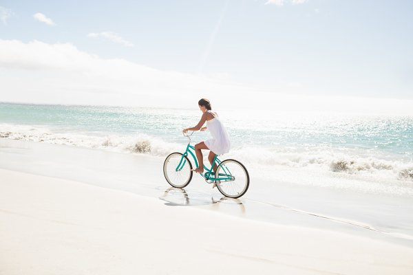 Carefree woman going on a bike ride