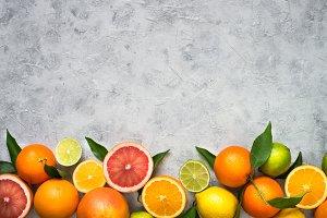 Citrus fruit on grey concrete table.