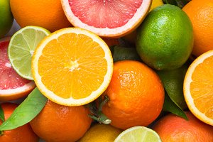 Citrus fruit. Whole and sliced fruits