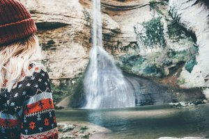 Traveler enjoying waterfall view