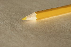 Yellow pencil over paper