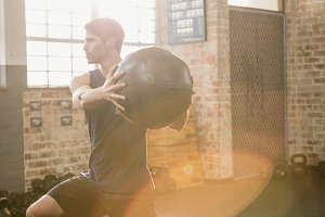 Man doing exercise with medicine ball