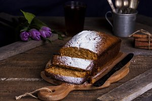 cake with honey, coconut and spices on wooden background