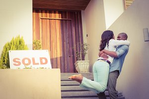 Happy couple after buying new house