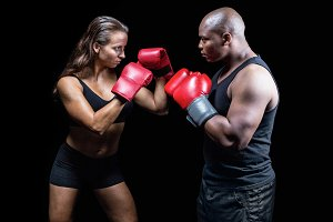 Male and female boxer with fighting stance
