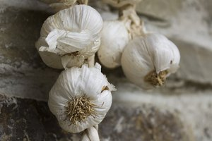 Bunch of organic garlic hanging on wall in bulgarian village.