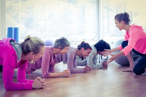 Smiling group of women exercising on floor