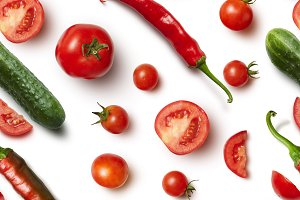 Red chili pepper, cucumber and tomato on white background .