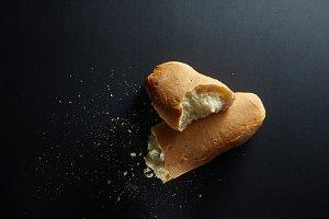 Fresh baked bread loaf broken