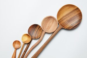 different kitchen wooden utensils on a white background