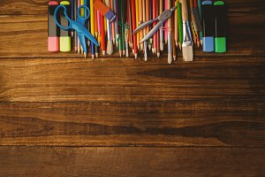 Art supplies on desk with copy space