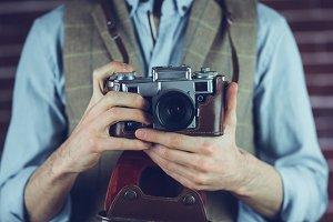 Photogrpaher holding camera