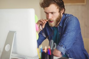 Focused hipster working at his desk