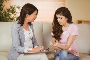 Therapist listening to her upset patient