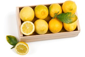 Organic lemons in box, above view.