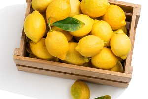 Lemons in a crate, above view.