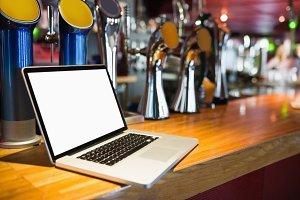 Laptop on bar counter