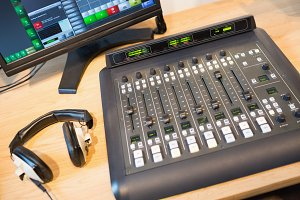 Sound mixer at desk in radio station