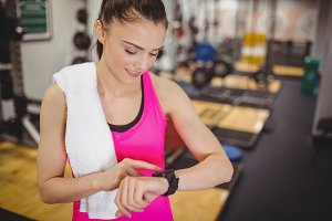 Fit woman using her smartwatch