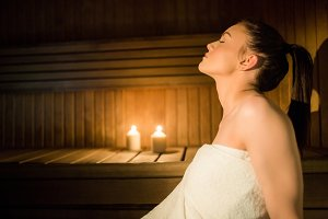 Pretty woman relaxing in the sauna