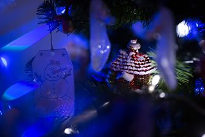Christmas decoration on fur-tree in blue lights