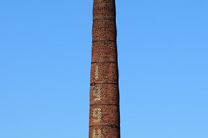 brick factory chimney. Tube for propulsion bricks in the furnace. Pipe on a background of blue sky