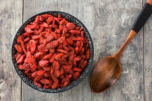 Goji berries and wooden spoon