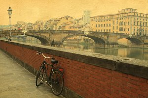 Vintage bridge on the river in Florence , Italy