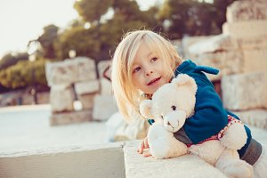 Portrait of a little girl hugging Teddy bear
