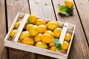 Wooden crate full of lemons