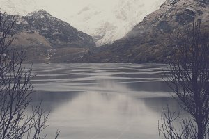 Snowy Mountains and Lake in Norway