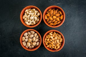 Four bowls with different nuts