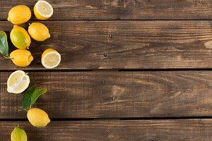 Juicy lemons with leaves, top view.