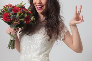 Bride doing victory sign