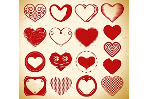 Set of vintage heart signs on grungy paper