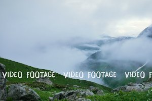 Time lapse of fog and clouds greatly reduce visibility in high mountain green spring hills