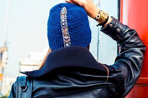 young lady wearing blue knitted hat