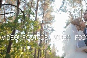 Bride and groom posing  in the wood