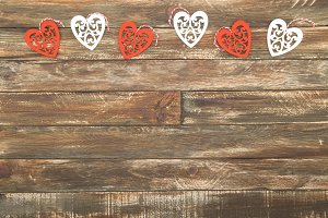 Floral Hearts Hanging over vintage Brown Wooden Background
