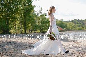 Tatooed bride pose to photographer.