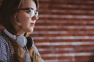 Focused hipster businesswoman with headphone
