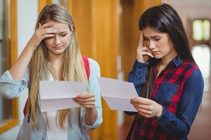 Anxious students looking at results