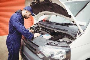 Mechanic fixing a van