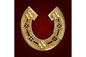 Set of gold horseshoes for good luck