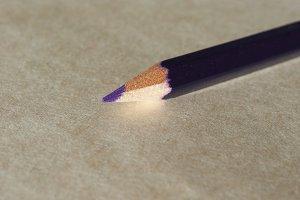 Violet pencil over paper