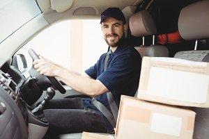 Delivery man driving his van