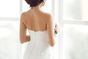 Beautiful bride in front of a window
