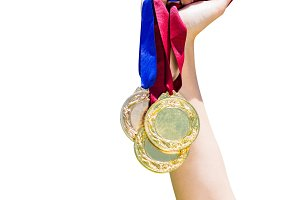 Hand holding three medals
